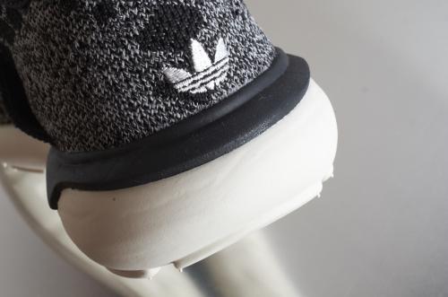 adidas Tubular Runner – Core Black / Carbon / Vintage White