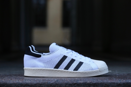 adidas Originals Superstars 80s Primeknit – White / Core Black / Gold Metallic