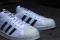 adidas Originals Superstars 80s Primeknit – White / Core Black / Gold Metallic