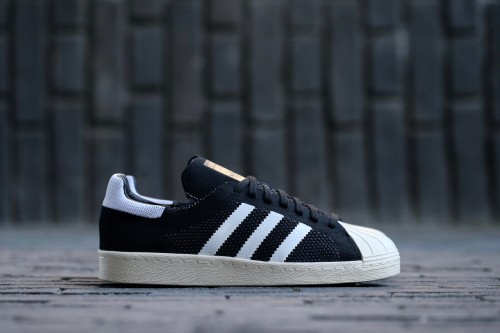 adidas Originals Superstars 80s Primeknit – Core Black / White / Gold Metallic