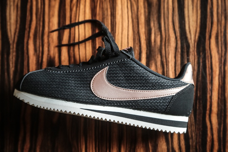 nike classic cortez leather lux trainers in black and metallic bronze